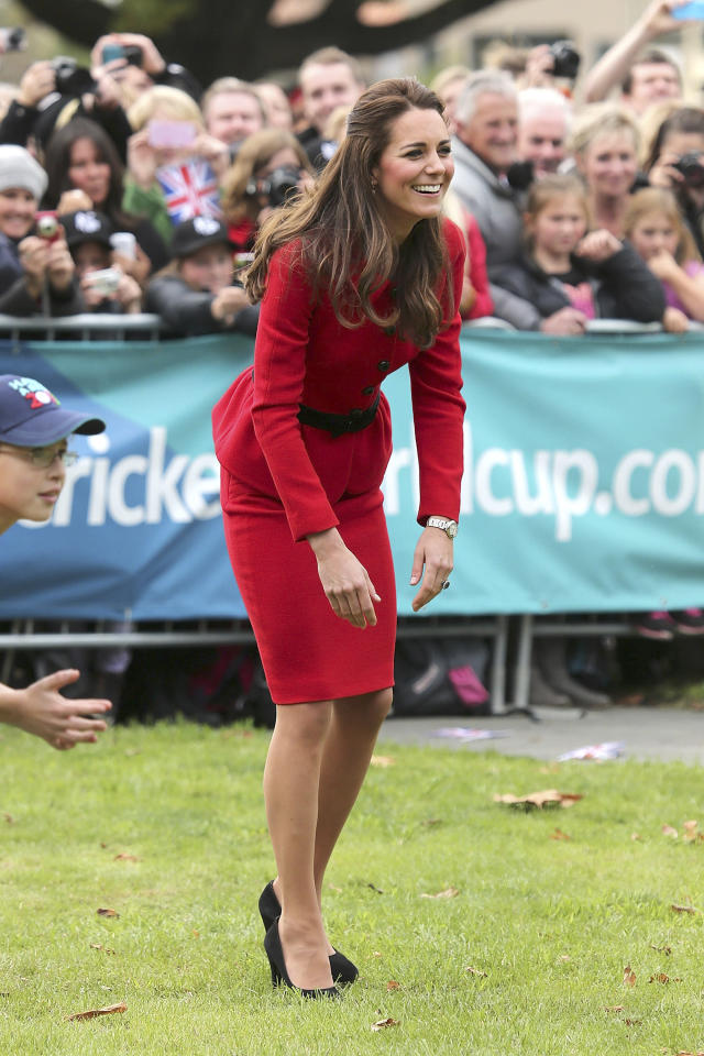 Britain's Kate, the Duchess of Cambridge, smiles while playing cricket in Latimer Square in Christchurch, New Zealand, Monday, April 14, 2014. Prince William and his wife Kate are on a three-week tour of New Zealand and Australia with their son, Prince George. (AP Photo/Martin Hunter, Pool)