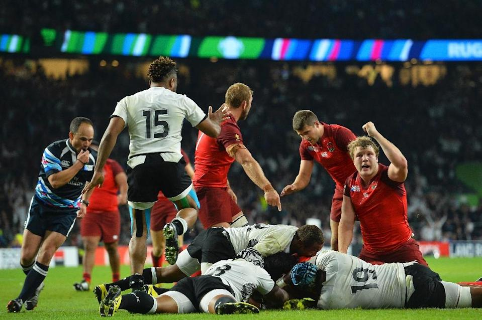 England's Joe Launchbury (R) celebrates after Billy Vunipola (hidden) scores against Fiji in their 2015 Rugby World Cup match on September 18, 2015 (AFP Photo/Glyn Kirk)