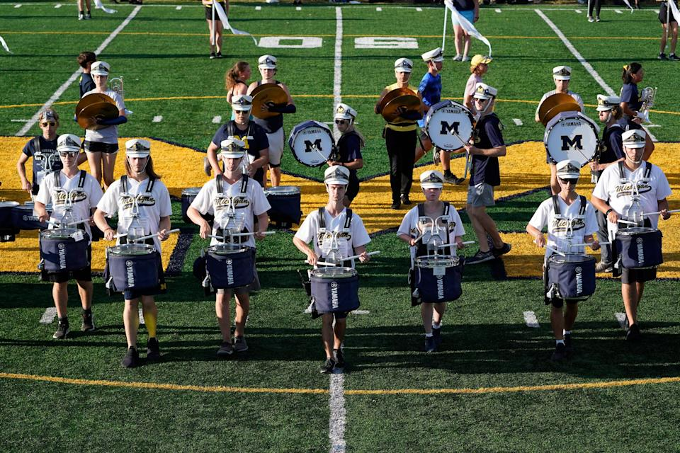 Members of the University of Michigan Marching Band rehearse for an NCAA football game in Ann Arbor, Mich., Wednesday, Sept. 8, 2021. The University of Michigan marching band will perform a halftime show on Saturday, the 20th anniversary of the Sept. 11 terror attacks.