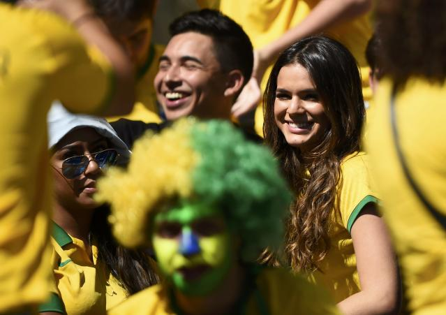 Bruna Marquezine, girlfriend of Brazil's Neymar, waits for the start of the 2014 World Cup round of 16 game between Brazil and Chile at the Mineirao stadium in Belo Horizonte June 28, 2014. REUTERS/Dylan Martinez (BRAZIL - Tags: SOCCER SPORT WORLD CUP ENTERTAINMENT)