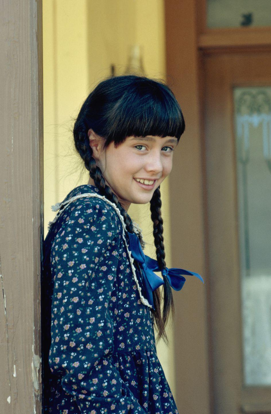 <p>Before she strolled through the halls of West Beverly High School in <em>90210</em>, Shannen Doherty booked gigs as a child actress in television and film, including <em>Little House on the Prairie </em>in 1982.</p>