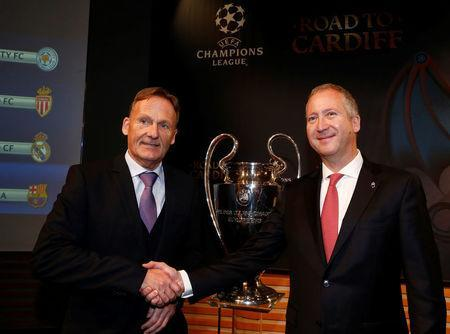 Borussia Dortmund CEO Hans-Joachim Watzke (L) shakes hands with AS Monaco Vice President Vadim Vasilyev after the draw of the UEFA Champions League quarterfinals in Nyon, Switzerland March 17, 2017. REUTERS/Denis Balibouse