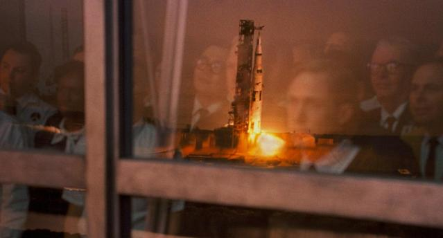 Ryan Gosling's Neil Armstrong watches a rocket launch in 'First Man' (Universal Pictures)