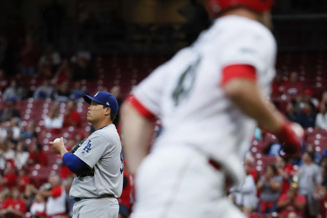 Los Angeles Dodgers starting pitcher Hyun-Jin Ryu, left, stands on the mound after giving up a solo home run to Cincinnati Reds' Scott Schebler, right, in the third inning of a baseball game, Tuesday, Sept. 11, 2018, in Cincinnati. (AP Photo/John Minchillo)