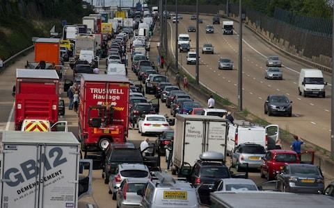 "M25 Motorists are stranded on the M25 after ...Motorists are stranded on the M25 after a road accident closed a section of the motorway orbital in London on August 16, 2013. Eight people were reported to be injured and motorists warned of delays following a ""serious collision"" on the M25 involving ""up to seven vehicles"". AFP PHOTO / ANDREW COWIEANDREW COWIE/AFP/Getty Images - Credit: ANDREW COWIE /AFP"