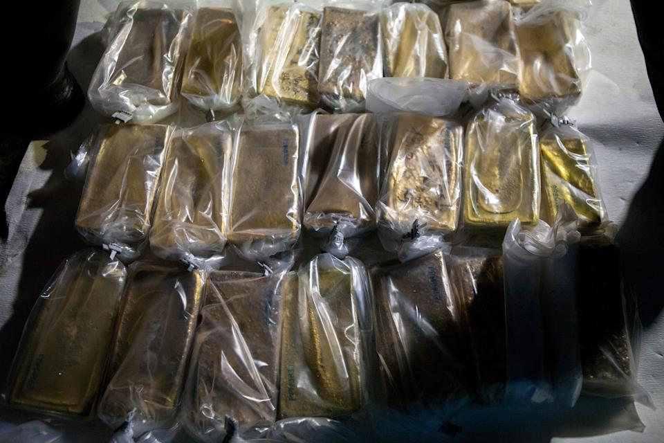 Gold bars wrapped in plastic sit ready for transportation. Photo: Manaure Quintero/Bloomberg