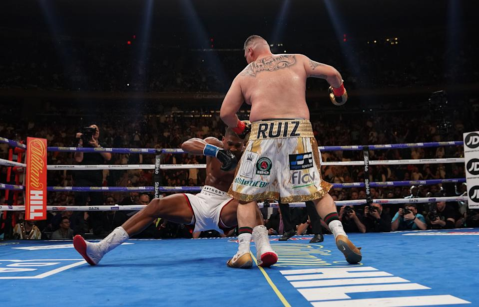 USA's Andy Ruiz (R) fights with England's Anthony Joshua (L) during their 12-round IBF, WBA, WBO & IBO World Heavyweight Championship fight at Madison Square Garden in New York on June 1, 2019. (Photo by TIMOTHY A. CLARY / AFP)        (Photo credit should read TIMOTHY A. CLARY/AFP via Getty Images)