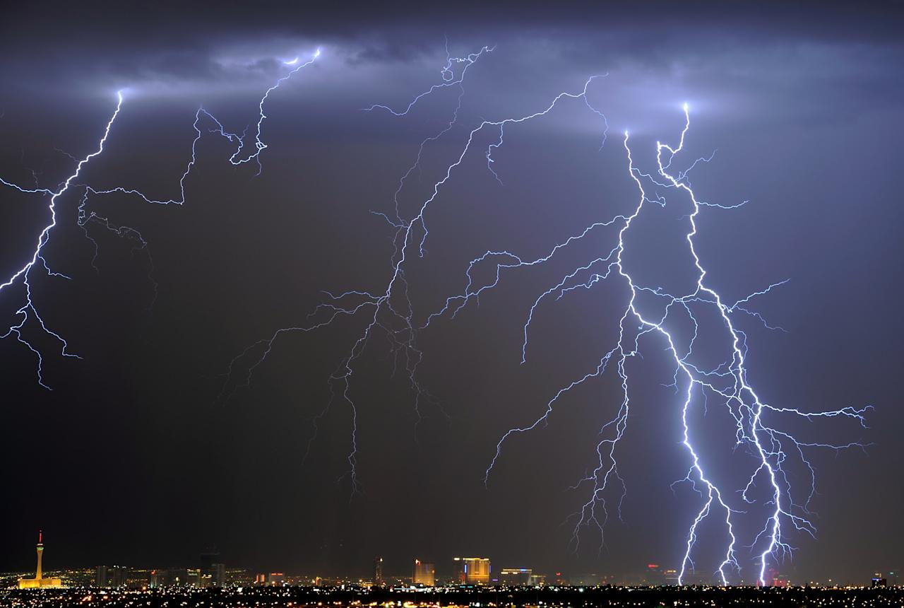 LAS VEGAS, NV - SEPTEMBER 13:  Lightning flashes over the Las Vegas Strip during a thunderstorm early on September 13, 2011 in Las Vegas, Nevada. Stormy weather is expected to continue through Thursday.  (Photo by Ethan Miller/Getty Images)
