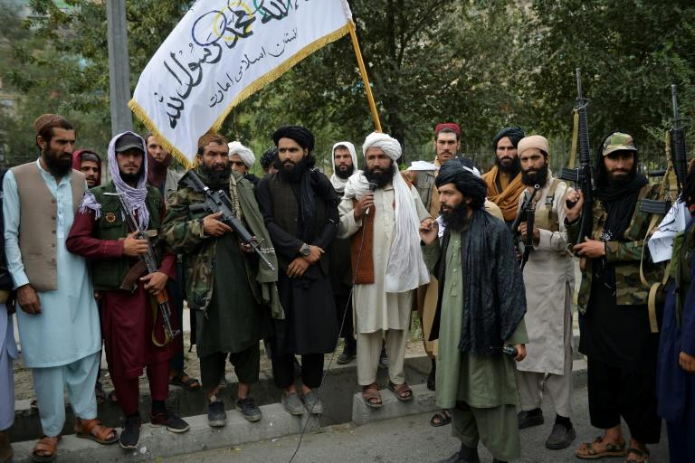Taliban fighters gather along a street during a rally in Kabul on August 31, 2021 as they celebrate the United States pulling all its troops out of the country (AFP/Hoshang Hashimi)