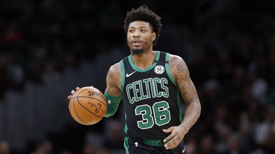Marcus Smart announced that he has joined a growing list of NBA players confirmed with COVID-19. (AP Photo/Michael Dwyer)