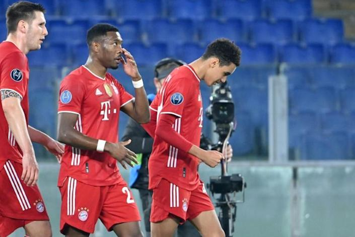 Bayern Munich's England Under-21 midfielder Jamal Musiala (R) celebrates scoring his first Champions League goal