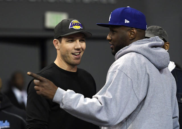 Lamar Odom talks with Lakers coach Luke Walton in March. (AP)