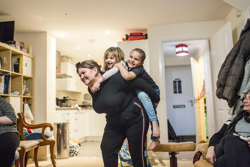 <p>Amy Chapman plays with Adbul, 4, and Noor, 6, at the Arnout family home in Devon</p>Andrew McConnel