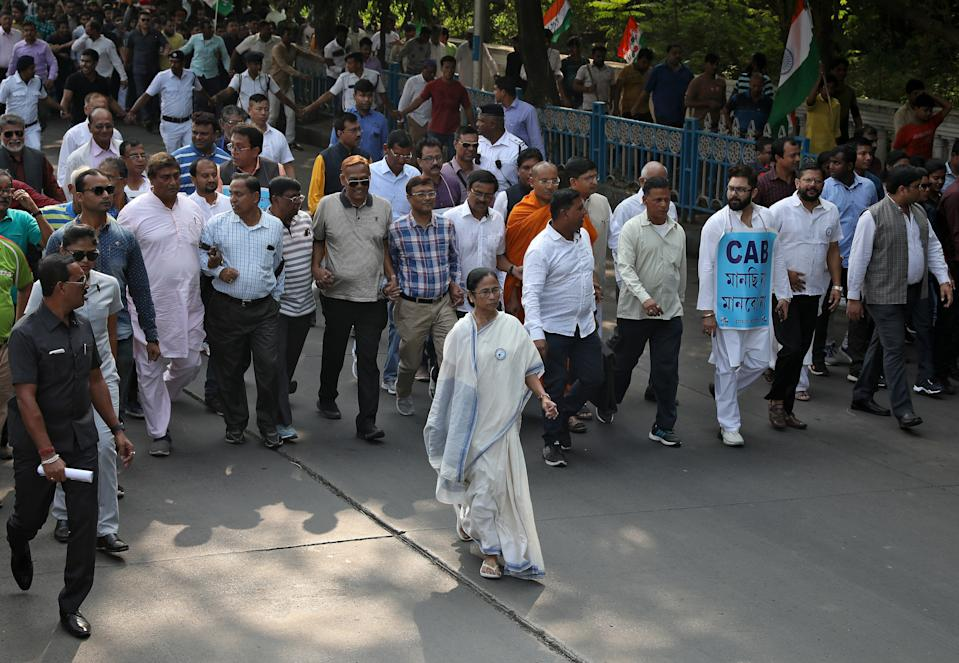 Mamata Banerjee, the Chief Minister of West Bengal, and her party supporters attend a protest march against the National Register of Citizens (NRC) and a new citizenship law, in Kolkata, India, December 16, 2019. REUTERS/Rupak De Chowdhuri