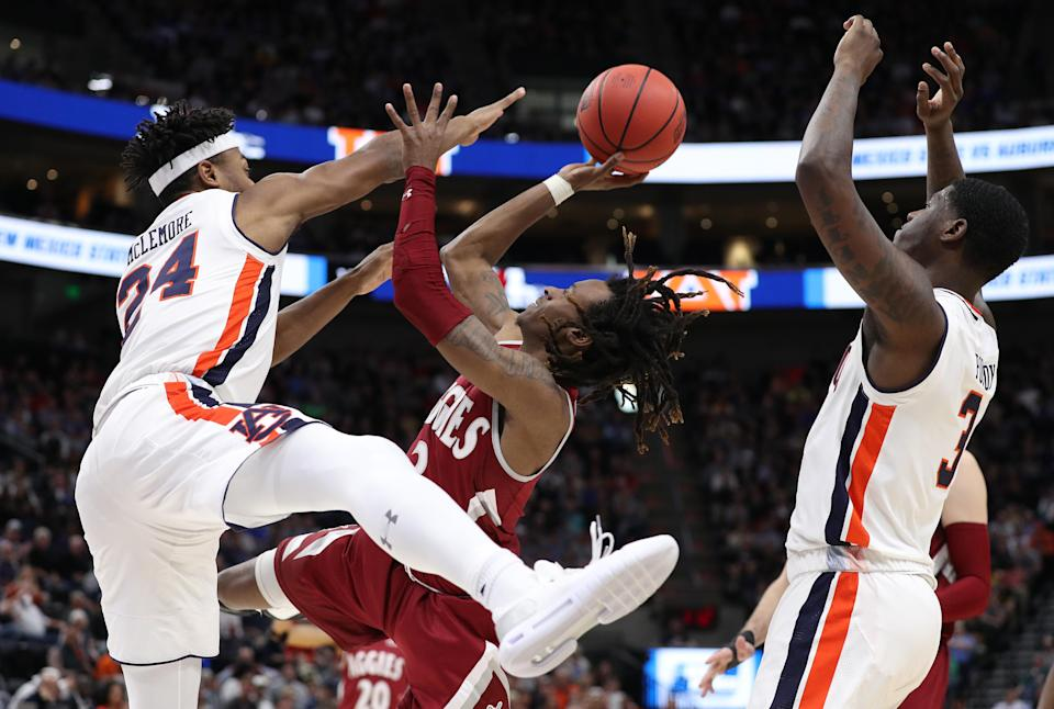 <p>Terrell Brown #3 of the New Mexico State Aggies attempts to shoot the ball against Anfernee McLemore #24 of the Auburn Tigers during the second half in the first round of the 2019 NCAA Men's Basketball Tournament at Vivint Smart Home Arena on March 21, 2019 in Salt Lake City, Utah. (Photo by Patrick Smith/Getty Images) </p>