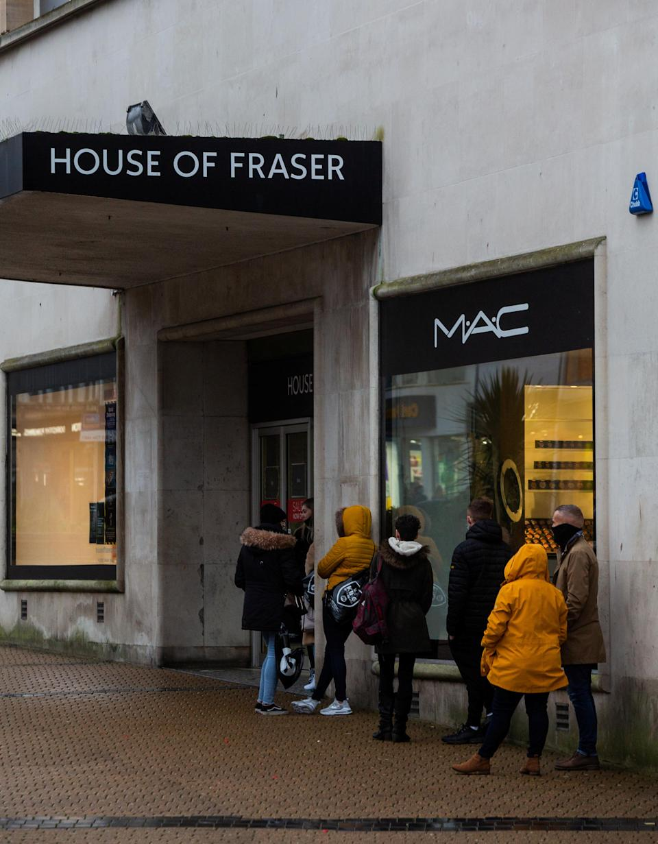 Some  shoppers queue outside of House of Fraser in Plymouth (swns)