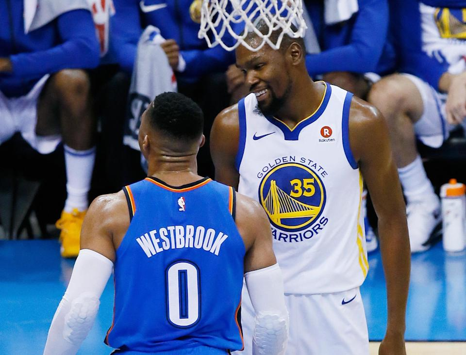 Kevin Durant spent his night smiling. Russell Westbrook spent his trying to wipe the smile off Durant's face. (AP)