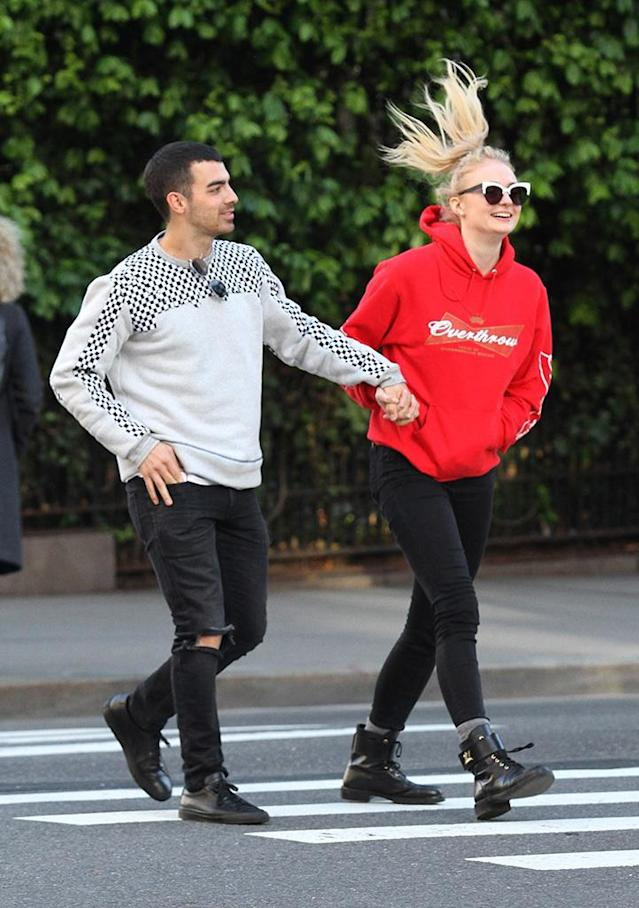 <p>The singer and the <em>Game of Thrones</em> actress could not have looked any happier together while skipping along the streets of NYC. Ah, young love. (Photo: Backgrid)<br><br><br></p>