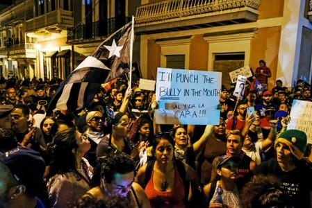 Demonstrators chant aduring the fourth day of protest calling for the resignation of Governor Ricardo Rossello in San Juan