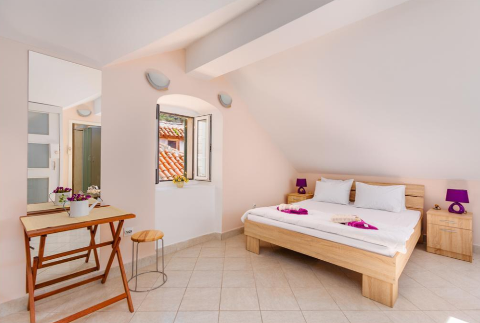 """<p><strong>Where to Stay:</strong> For your stay, settle in Kotor, a historic town off the Adriatic coast of Montenegro. The <a href=""""http://guest-house-455.kotor.hotels-kotor.com/en/"""" rel=""""nofollow noopener"""" target=""""_blank"""" data-ylk=""""slk:Guest House 455"""" class=""""link rapid-noclick-resp"""">Guest House 455</a> can cost as little as £35 a night. For that low cost, you'll have the Bay of Kotor and the city's impressive architecture just outside your door.</p><p><strong>Insider Tip:</strong> Lovers of the great outdoors should head to Lovćen, a national park in the southwestern part of Montenegro. The main attraction? The mausoleum that houses Petar Petrović Njegoš, a revered poet and philosopher of Monenegro.</p><span class=""""copyright"""">Photo: Courtesy of Guest House 455 Kotor.</span>"""