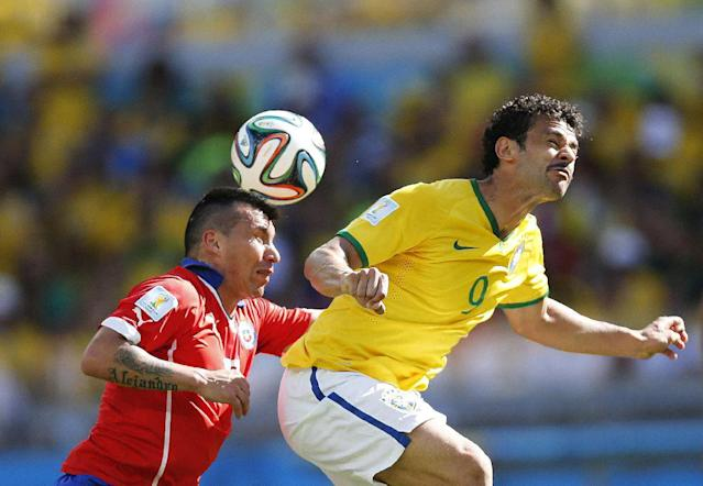 Chile's Gary Medel and Brazil's Fred go for a header during the World Cup round of 16 soccer match between Brazil and Chile at the Mineirao Stadium in Belo Horizonte, Brazil, Saturday, June 28, 2014. (AP Photo/Frank Augstein)