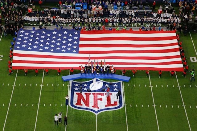 "The NFL and NFLPA released a statement on Thursday night announcing that both sides are actively working together to find a ""resolution to the anthem issue,"" and that the NFL won't enforce the current policy while the NFL and NFLPA engage in talks. (Getty Images)"