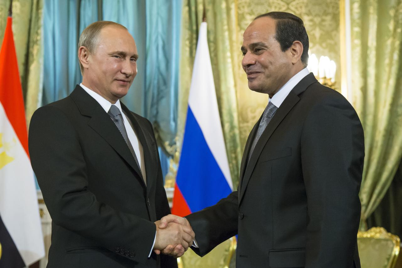 <p> FILE - In this Aug. 26, 2015 file photo, Russian President Vladimir Putin, left, shakes hands with Egyptian President Abdel-Fattah el-Sissi during their meeting in the Kremlin, Moscow, Russia. Egyptians go to the polls next week in what is essentially a one-candidate election -- but almost nowhere has democracy taken hold in the Arab world. While the democratic record is dismal, the Middle East is hardly alone in what seems to be a global trend away from liberal democracy. (AP Photo/Alexander Zemlianichenko, Pool, File) </p>