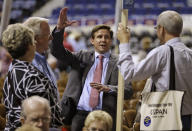FILE - In this May 17, 2013, file photo, candidate for Governor of Virginia, Pete Snyder, center, gestures as he talks to delegates during the opening of the Virginia Republican convention in Richmond, Va. The GOP gubernatorial candidate will be chosen during the party's May 8 nominating convention. (AP Photo/Steve Helber, File)