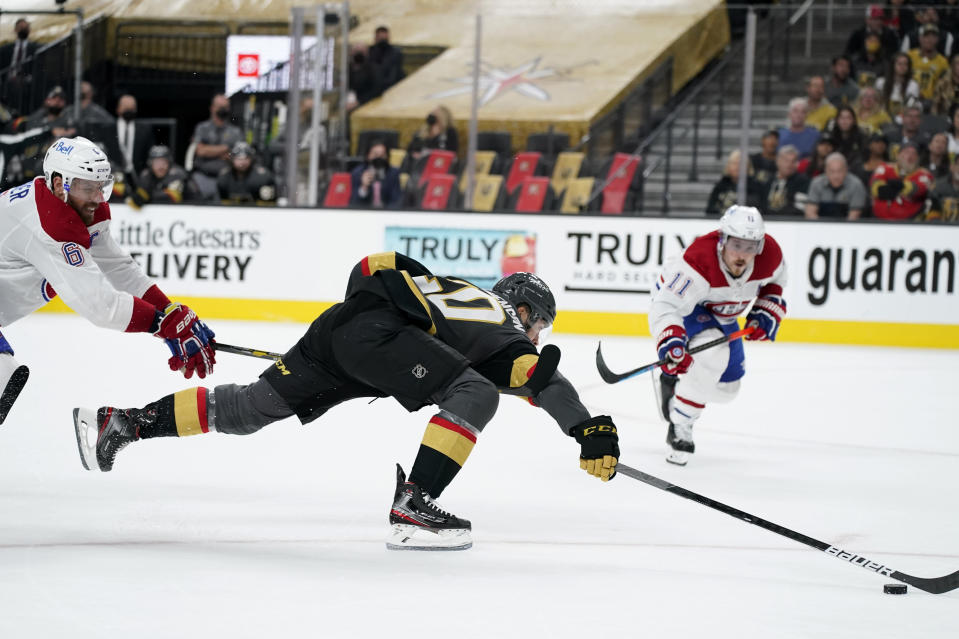 Vegas Golden Knights center Chandler Stephenson (20) battles against Montreal Canadiens defenseman Shea Weber (6) during the second period in Game 5 of an NHL hockey Stanley Cup semifinal playoff series Tuesday, June 22, 2021, in Las Vegas. (AP Photo/John Locher)