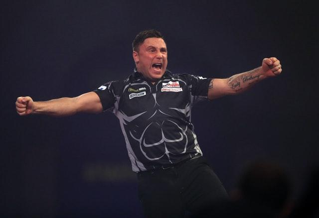 Gerwyn Price celebrates after booking his spot in Sunday's final (Adam Davy/PA)