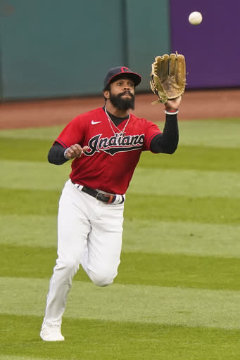 Cleveland Indians' Delino DeShields catches a ball hit by Kansas City Royals' Hunter Dozier for the out during the first inning of a baseball game, Thursday, Sept. 10, 2020, in Cleveland. (AP Photo/Tony Dejak)