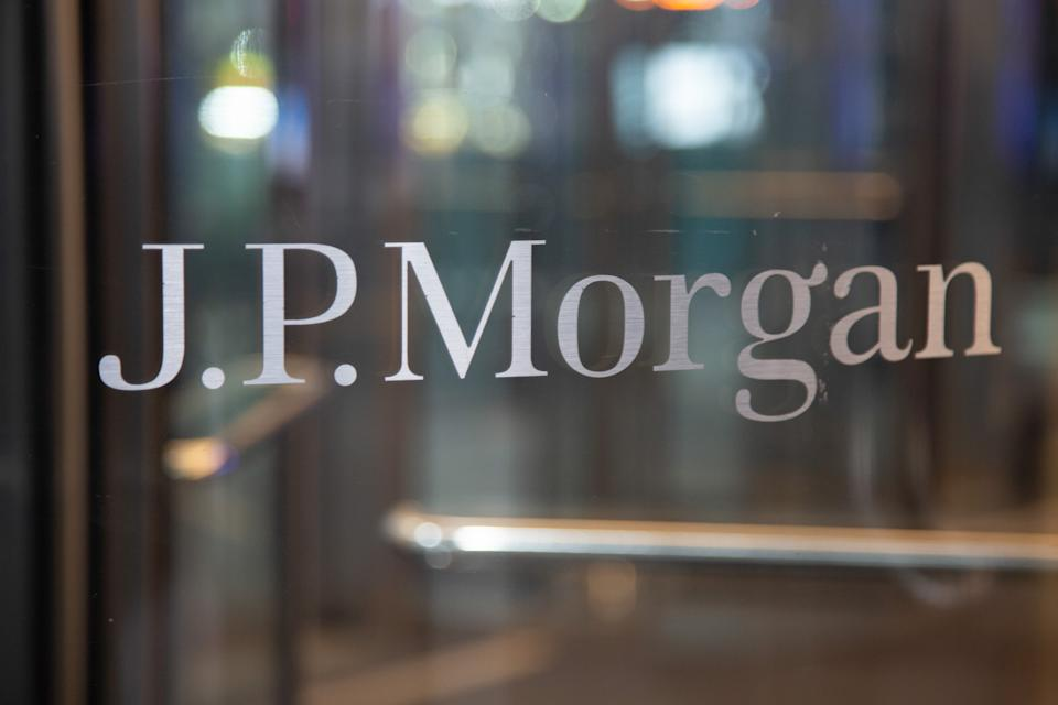The J.P. Morgan logo sign on the entrance of a glass office building in Midtown Manhattan, New York, USA on 23 January 2020. JPMorgan Chase & Co. is an American multinational investment bank and financial services holding company has the headquarters in New York City. NY, USA (Photo by Nicolas Economou/NurPhoto via Getty Images)