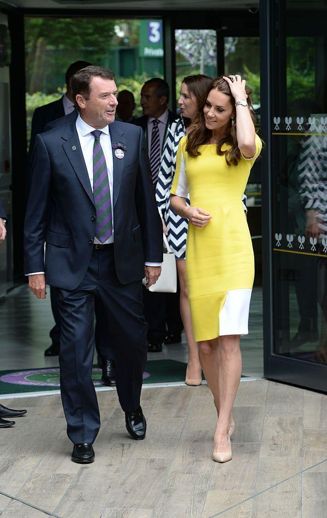 <p>The Duchess decided against wearing Wimbledon whites and resurfaced a bright yellow Roksanda Ilincic dress.</p>