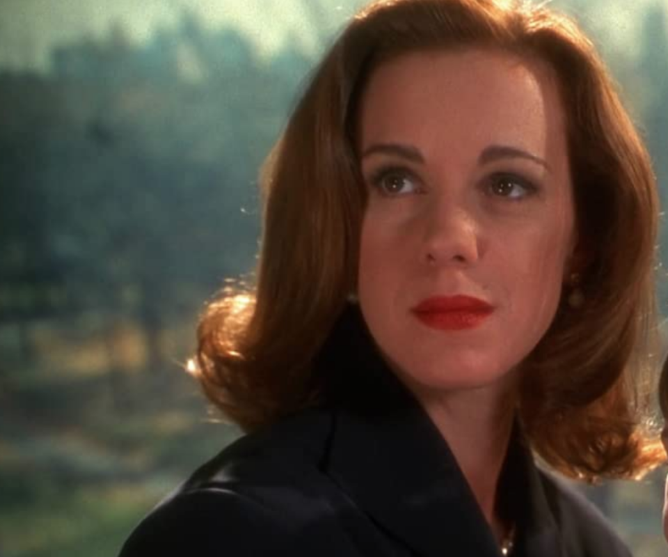 <p>Elizabeth Perkins was the perfectly polished mother in <em>Miracle on 34th Street </em>and her red pout in every scene is all the makeup department had to do to nail her vibe. Back then, red lipstick = perfect mother, duh.</p>