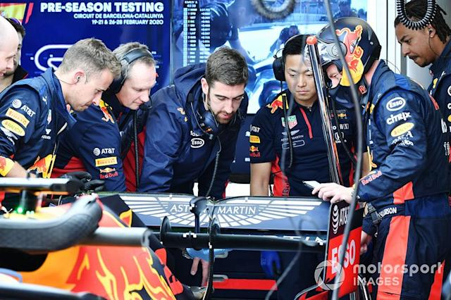 """Team members examine Red Bull Racing RB16 <span class=""""copyright"""">Mark Sutton / Motorsport Images</span>"""