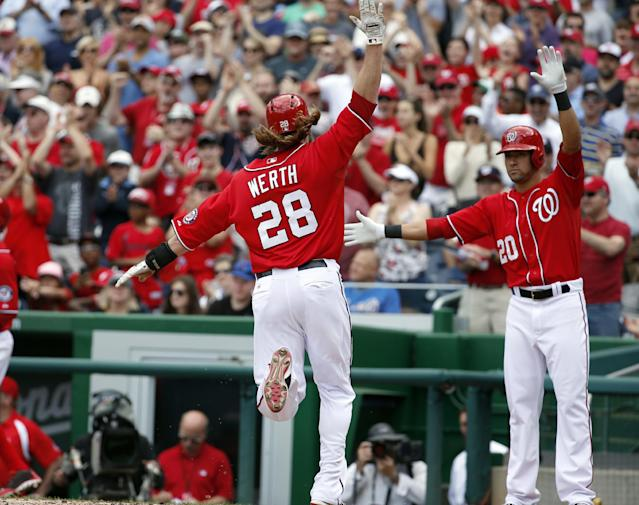 Washington Nationals' Jayson Werth (28) celebrates scoring with Ian Desmond (20), off a two-RBI double by Wilson Ramos, during the third inning of a baseball game against the New York Mets at Nationals Park Sunday, May 18, 2014, in Washington. (AP Photo/Alex Brandon)