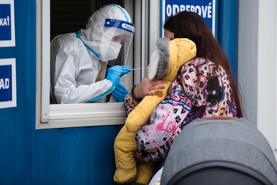 A health worker wearing a protective suit takes a nasal swab sample from a baby through a window during the COVID19 mass testing. As the Covid-19 situation in Slovakia remains critical, Slovak government with PM Igor Matovic have introduced mass testing of the population. Starting today 18th of January large-scale testing will continue until 26th of January. The government hopes the nationwide testing will speed up a recovery from the latest wave of the coronavirus. (Photo by Tomas Tkacik / SOPA Images/Sipa USA)