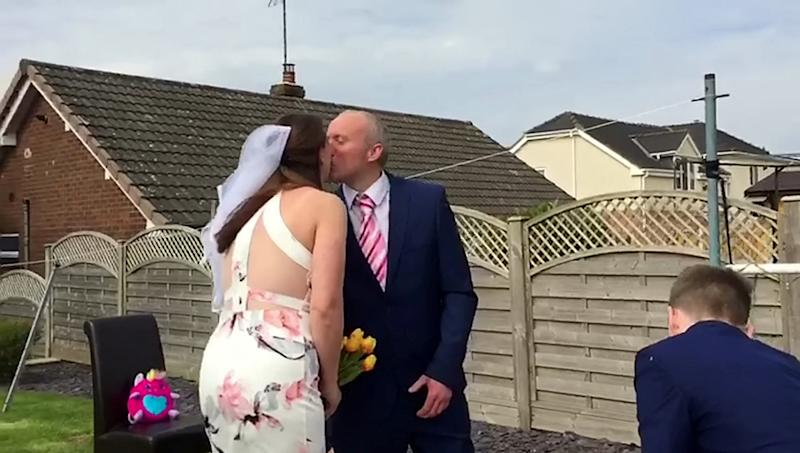 Their two children decorated the garden on the same day they had been due to get hitched (SWNS)