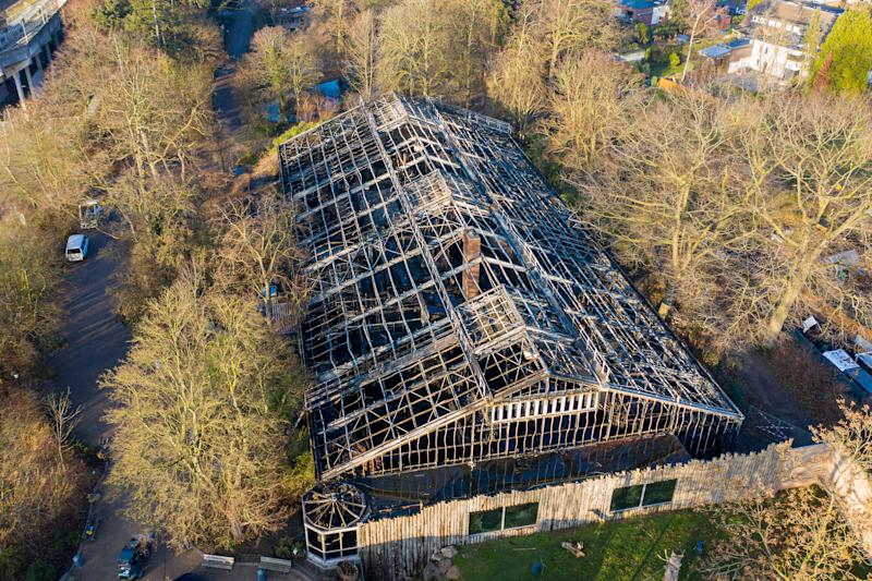 01 January 2020, North Rhine-Westphalia, Krefeld: The burnt down monkey house can be seen after the fire in the Krefeld Zoo on New Year's Eve. (recording with a drone). After the fire of the monkey house in Krefeld Zoo with many dead animals, there are, according to investigators, indications of so-called Chinese sky lanterns as the cause of the fire. Photo: Christoph Reichwein/dpa (Photo by Christoph Reichwein/picture alliance via Getty Images)