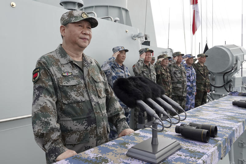 "FILE - In this April 12, 2018, file photo released by Xinhua News Agency, Chinese President Xi Jinping speaks after reviewing the Chinese People's Liberation Army (PLA) Navy fleet in the South China Sea. China plans to hold a multinational fleet review this month in the northern port of Qingdao to mark the 70th anniversary of the founding of the People's Liberation Army Navy. China's most memorable fleet review came just over a year ago in the South China Sea, when President Xi said that, ""The mission of building a mighty people's navy has never been more urgent than it is today,"" in an address delivered from the helicopter deck of one of China's most advanced destroyers. (Li Gang/Xinhua via AP, File)"