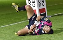 Stade Francais' No 8 Raphael Lakafia celebrates after scoring a try during their French Top 14 rugby union match against Toulon, at the Jean Bouin stadium in Paris, on September 6, 2015 (AFP Photo/Loic Venance)