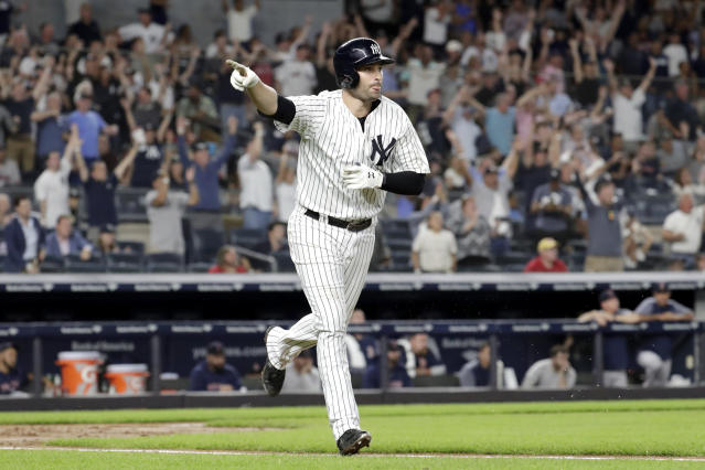 New York Yankees' Neil Walker gestures toward the dugout after hitting a three-run home run off Boston Red Sox relief pitcher Ryan Brasier during the seventh inning of a baseball game Tuesday, Sept. 18, 2018, in New York. (AP Photo/Julio Cortez)