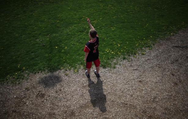 Parker Roos, who suffers from Fragile X, flies a kite in Canton, Illinois, April 4, 2012.