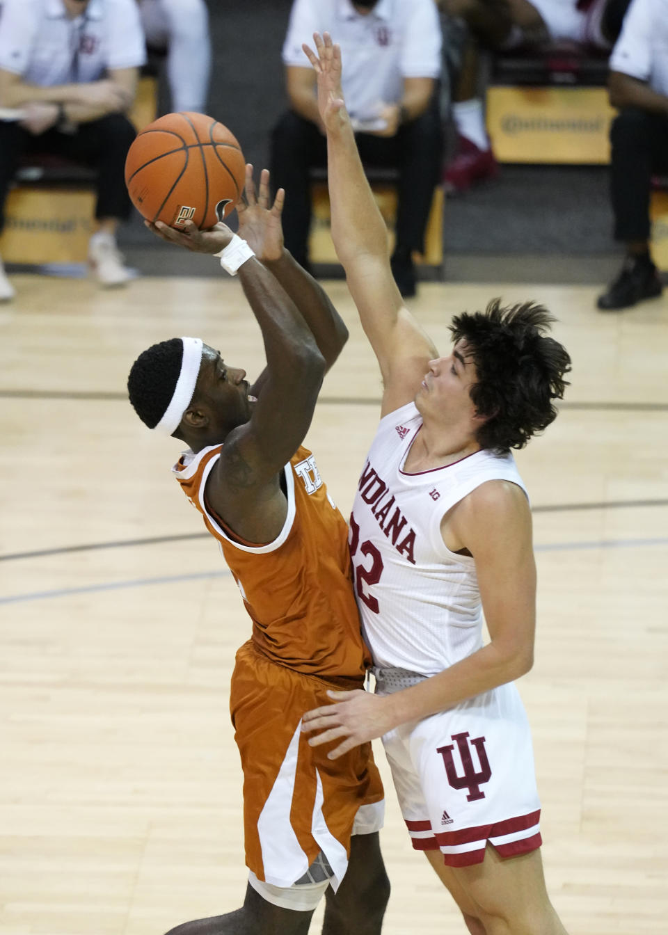 Texas guard Courtney Ramey (3) drives to the basket against Indiana guard Trey Galloway (32) in the first half of a semifinal NCAA college basketball game in the Maui Invitational tournament, Tuesday, Dec. 1, 2020, in Asheville, N.C. (AP Photo/Kathy Kmonicek)