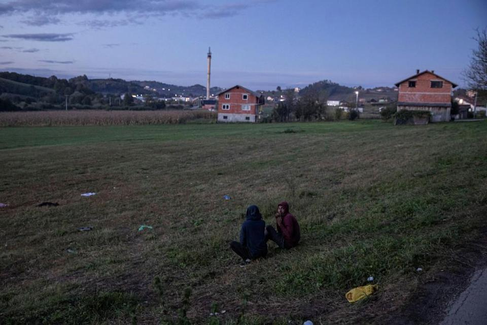 Migrants gather before trying to cross the Bosnia-Croatia border near Velika Kladusa