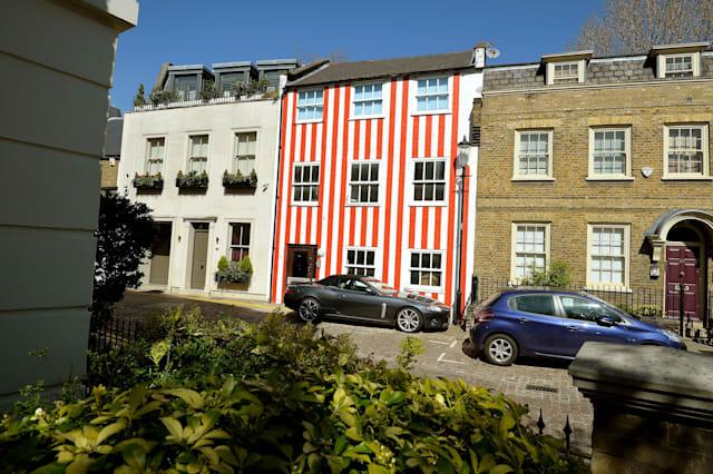 Red and white striped house
