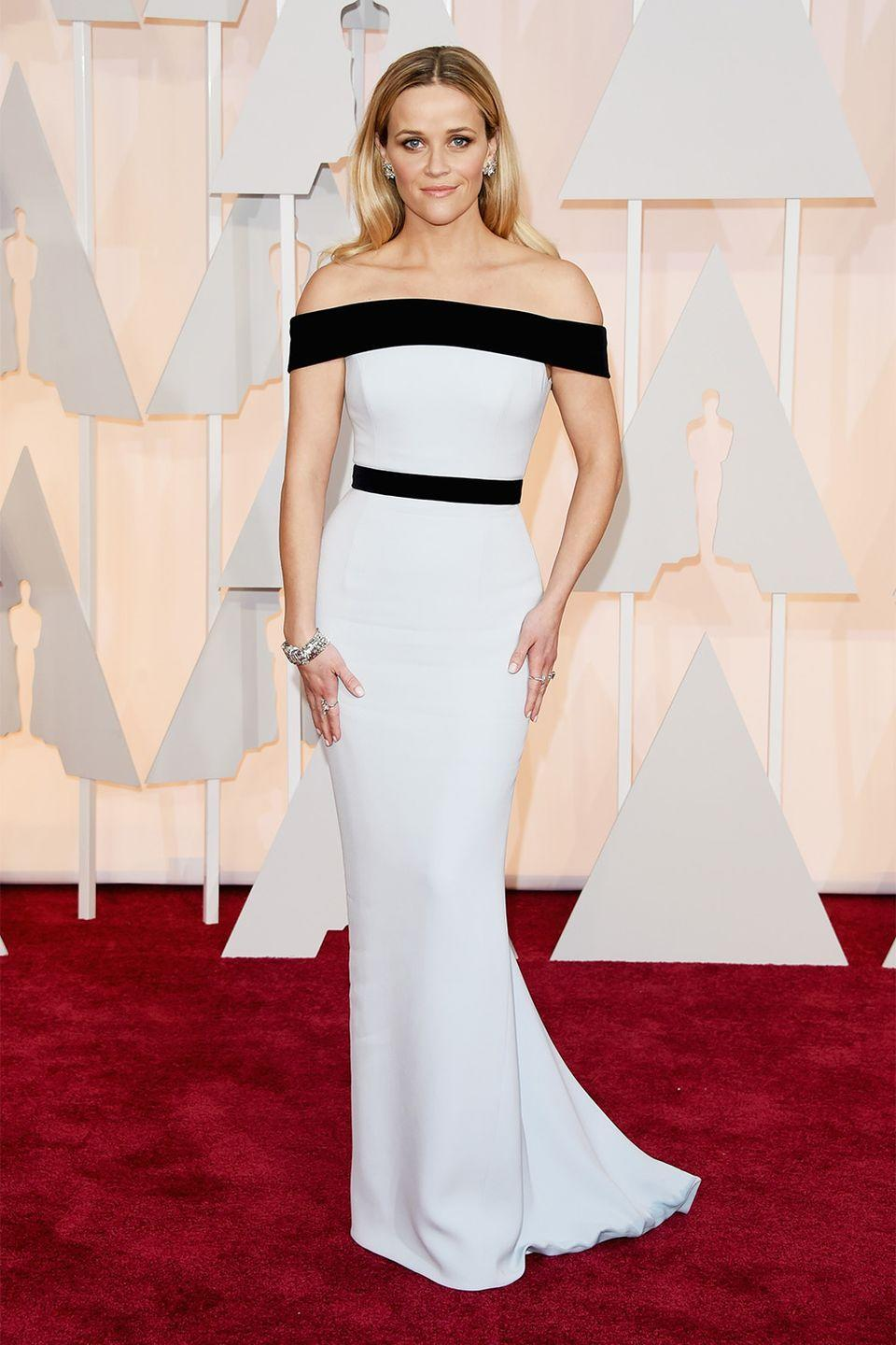 <p>Sometimes simple is best, and Reese Witherspoon proved that in this high-contrast Tom Ford dress. </p>