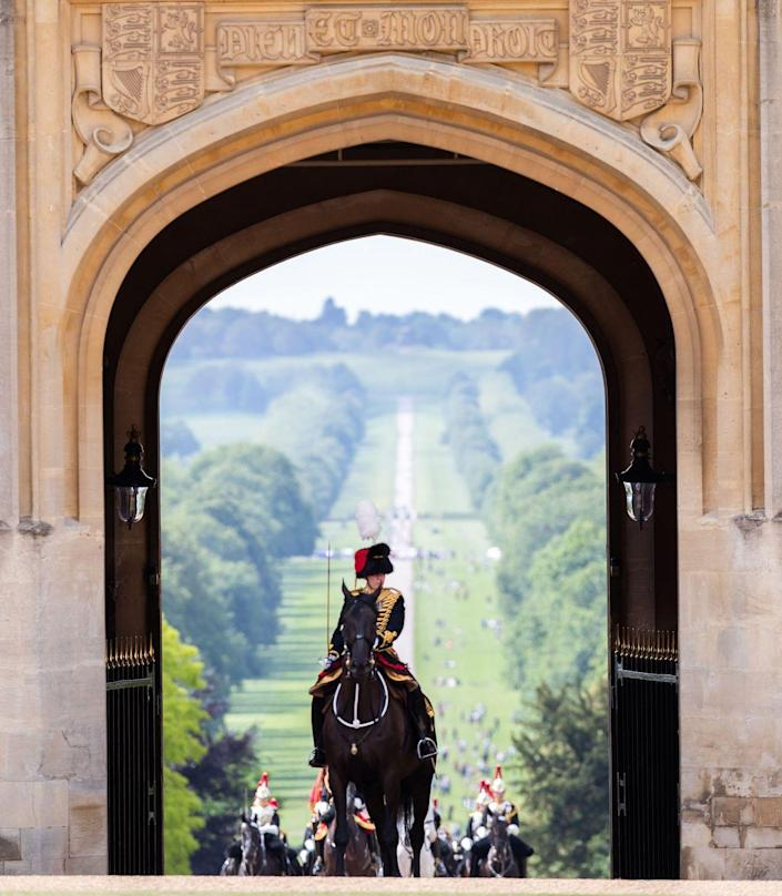 <p>Members of the Household cavalry arrive into the Quadrangle during a military ceremony to mark the Official Birthday of Queen Elizabeth II at Windsor Castle.</p>