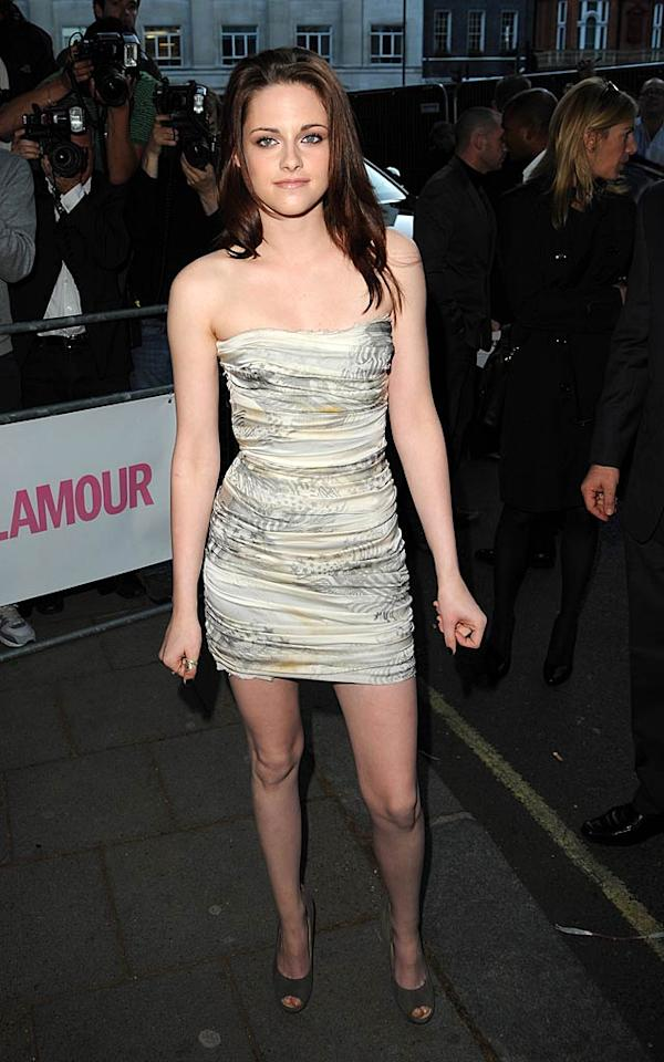 """Meanwhile in London -- at the Glamour Women of the Year Awards -- """"Twilight's"""" Kristen Stewart flaunted her signature stems in a beautiful, beachy Balmain mini and gray Giuseppe Zanotti suede peep-toes. Eamonn McCormack/<a href=""""http://www.gettyimages.com/"""" target=""""new"""">GettyImages.com</a> - June 7, 2011"""