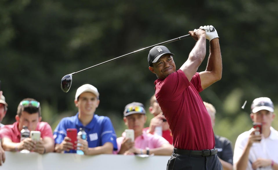 Tiger Woods watches his shot on the fifth hole during the final round of the Northern Trust golf tournament, Sunday, Aug. 26, 2018, in Paramus, N.J. (AP Photo/Mel Evans)